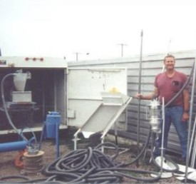 man with sampling equipment and trailer