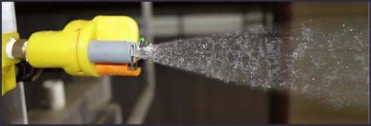 Spray atomization from a nozzle.