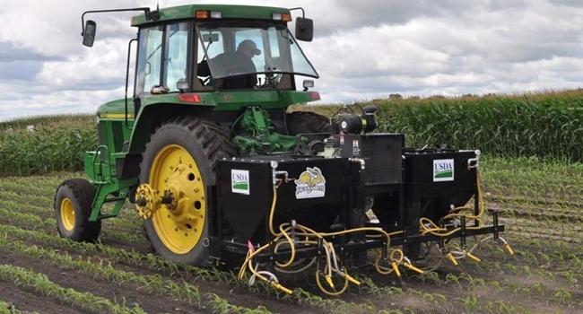 PAGMan is a tractor-mounted implement with a PTO-driven air compressor that feeds abrasive grit to eight nozzles for postemergence control of small annual weeds. PAGMan is a joint project by USDA-ARS, Morris, MN and South Dakota State University. Photo by Dean Peterson