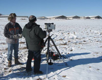 Image of two scientists measuring ammonia emissions during the winter.
