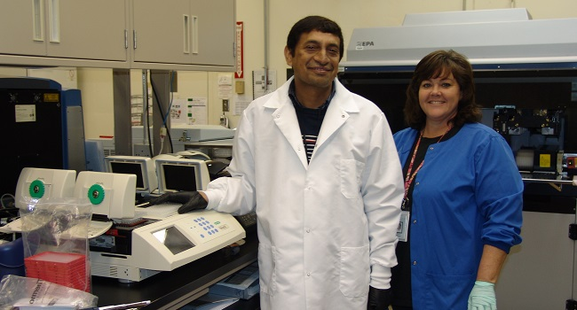 Cotton Leaf Curl Collaborator, Dr. Mehboob-ur-Rahman with Genotyping expert, Sheron Simpson
