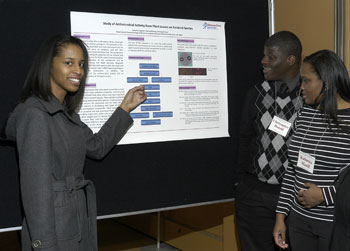 Talaysha Linghan presents her poster to fellow students