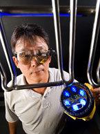 Biophysicist Moon Kim tests a portable imaging device, photo by Stephen Ausmus