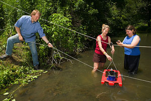 Using an Acoustic Doppler Channel Profiler to assess water velocity and channel geometry, Photo by Peggy Greb, ARS Image D632-1