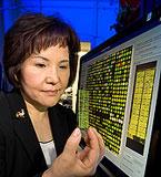 Immunologist Hyun Lillehoj holds a chicken gene chip