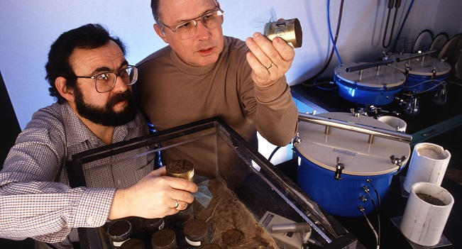 Soil scientist Yakov Pachepsky (left) and hydrologist Walter Rawls examine soil samples from fields where yields and soil pore geometry are different. The ability of soils to retain and transport water is closely related to fractal parameters of pore space.