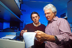 Photo: Microbiologist Willard Goff (right) and veterinary medical officer Don Knowles examine data from an automated spectrometer. Link to photo information