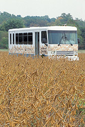 Photo: The ARS National Visitor Center tour bus fueled with soy-based biodiesel passes a soybean field ready for harvesting. Link to photo information