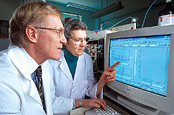 Photo: Chemists Richard Anderson and Marilyn Polansky use high-performance liquid chromatography to identify compounds from cinnamon that improve the action of insulin. Link to photo information