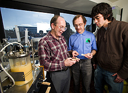 In laboratory, three scientists examine samples of new biobased glue. Link to photo information
