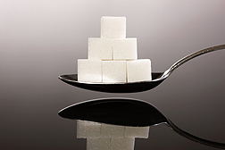 Sugar cubes on a spoon. Link to photo information