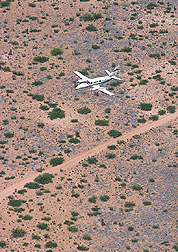Photo: ARS pilot Michael Ren• Davis flies the Cessna over the Jornada Range. Link to photo information