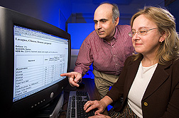 David Haytowitz and Pamela Pehrsson view computer screen displaying the lab's online search program. Link to photo information