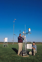 Photo: Agricultural engineers Terry Howell (left) and Thomas Marek maintain a weather station at the ARS Bushland experimental North Plains Evapotranspiration Network. Link to photo information