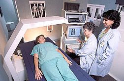 Nutritionist and nurse prepare to measure body composition of a potential participant in an earlier study. Link to photo information