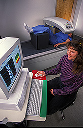 Photo: Physiologist makes a bone density measurement of a research volunteer. Link to photo information