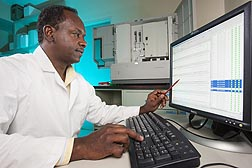 Photo: ARS molecular biologist examines genetic markers in sugar beets. Link to photo information