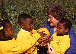 Margaret Bogle with students from the Child Development Center.