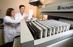 Photo: ARS nutritional immunologists Simin Meydani (left) and Dayong Wu review data generated from a gamma counter. Link to photo information
