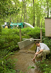 Photo: Soil scientist Andrey Guber takes water samples from Beaverdam Creek.