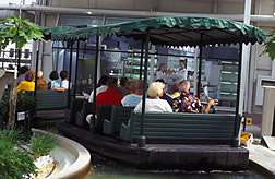Tourists take a boat ride past an ARS biotechnology lab in The Land exhibit at Epcot.