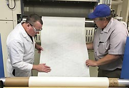 ARS researchers inspect nonwoven fabric for use in cotton-based wipes. Link to photo information