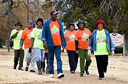 Eight members of Marvell Walking Club stroll on community walking trail. Link to photo information