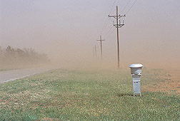 Dust storm along a road in west Texas. Link to photo information