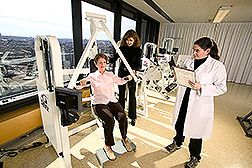 Jennifer Layne and Charlotte Mallio test a volunteer's muscle strength. Link to photo information