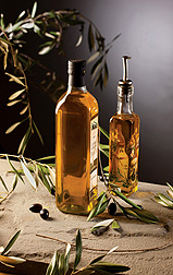 Photo: Two bottles of olive oil standing on a table. Link to photo information