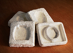 Photo: Biodegradable packaging material made from a blend of cotton gin waste and fungi extruded to fit four different shapes. Link to photo information