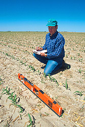 Photo: Agricultural engineer Gerald Buchleiter collects electromagnetic conductivity data to assess water and nitrogen levels in soil. Link to photo information