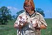 Researcher holding 10 day old piglets