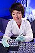 Biochemist prepares tissue samples.