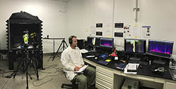 ARS entomologist, Rodrigo Krugner listens to mating communication of glassy winged sharpshooters in the laser room at the Crop Diseases, Pests and Genetics Research Unit.
