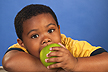 A boy eating an apple