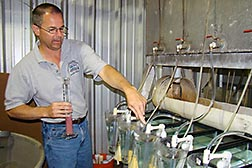ARS aquatic toxicologist Dave Straus adds fish eggs to hatching chambers.   Link to photo information