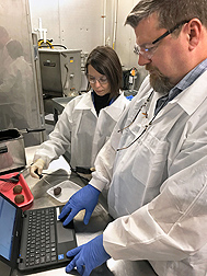 ARS food technologist Anna C. S. Porto-Fett and microbiologist John B. Luchansky measure the temperature of meatballs. Link to photo information
