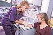 A technician collects a blood sample from a 7th grader