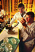 Entomologist and technician examining insect cell cultures.