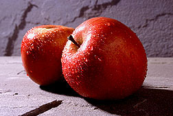 Photo: Two red apples with water droplets