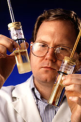 Photo of scientist inspecting bio-based fuel.