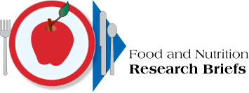 Table place setting with apple. Title: Food and Nutrition Research Briefs. Link to FNRB home page