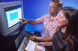 Photo of ARS scientists William Horn and Nancy Keim reviewing study data on computer