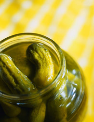 Photo: Close-up of a jar of pickles.