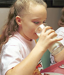 Schoolgirl drinking milk. Link to photo information