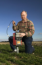 David Nielsen operates neutron probe to measure soil moisture. Link to photo information