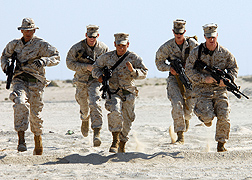 Photo: Five U.S. marines in desert uniforms running.