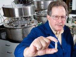 Photo: Chemist Mark Schmitt examines a test tube sample of malting barley.