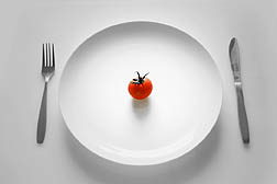Photo: Cherry tomato on a dinner plate.